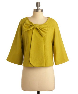 A ladylike coverup in deep chartreuse.