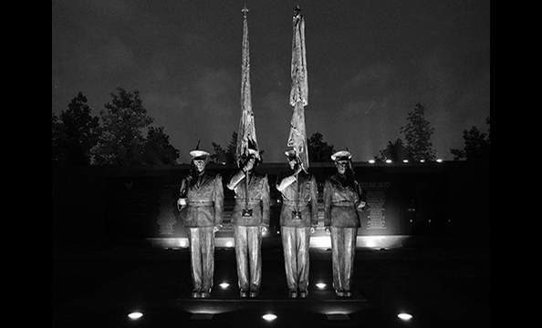 "The photographer shot ""Honor Guard"" at the US Air Force Memorial in Arlington as part of her ongoing project to photograph all of the area's memorials, statues, and monuments.  ""I liked the nighttime lighting and thought it would be pretty cool in black a"