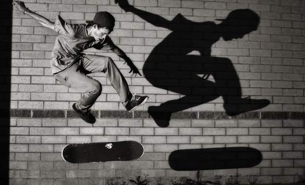 """Skateboard Shadow"".  Gibson, a 17-year-old senior at Chantilly High School, regularly skates with friend Troy Hellman.  One night, Gibson decided to bring along his camera gear, a Canon EOS 40D with a 16-to-35 millimeter lens and an external flash.  He t"