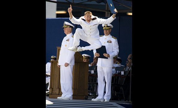 "'Grad Gets Air"".  The winner of our first-ever photo contest, Ventura's photograph shows his eldest son, Christopher, moments after receiving his diploma from the Naval Academy.  Ventura says his son tipped him off that he'd celebrate with a leaping heel"