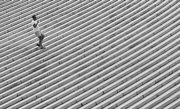 """""""Runner"""", an off-kilter shot of a runner near the Lincoln Memorial, won with 49 percent of the reader vote.  Arlington resident Eric Brown, who shoots with a Pentax DSLR camera, snapped the photo as part of a sunrise photo outing.  """"I love how it's angled"""