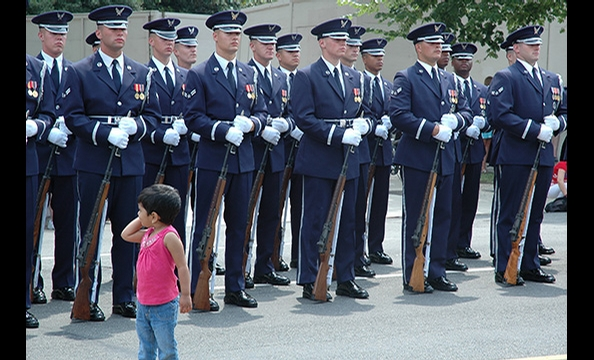 """Guards of Honor"" was taken at a 2007 Independence Day parade.  Two-and-a-half year old Mythili, Menon's daughter, wandered into the frame while he was shooting a photo of the honor guard.  ""Everyone looked so serious,"" Menon says. ""But there was my daugh"