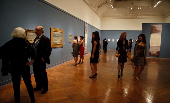 Guests taking in the art exhibits upstairs.