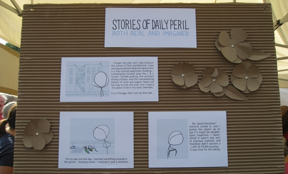 A vendor's Statement of Purpose board accented with pretty cardboard flowers.