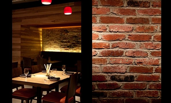 The restaurant has industrial accents like exposed brick and steel ceiling beams.