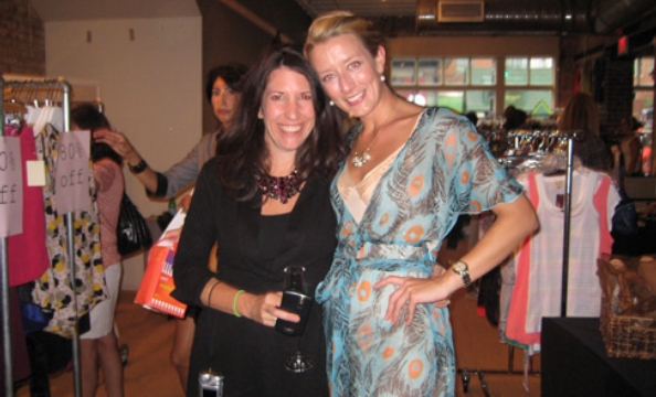 Barbara Martin and Liberty Jones pose in front of the District Sample Sale scene.