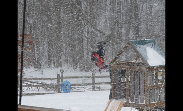 An eight-year-old doing a backflip off a jungle gym