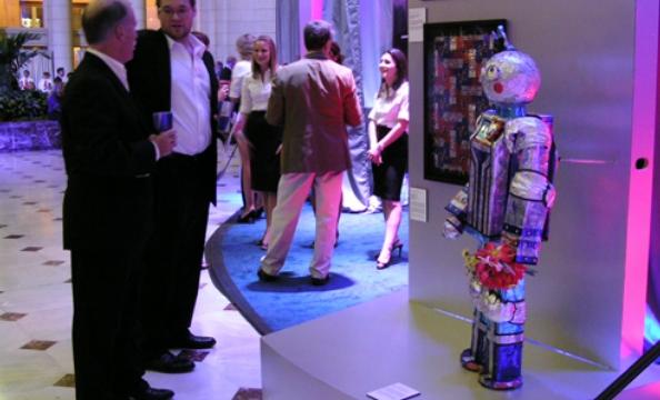 "Attendees and Lisa Lofton's ""Boyfriend Operating Bionic."""
