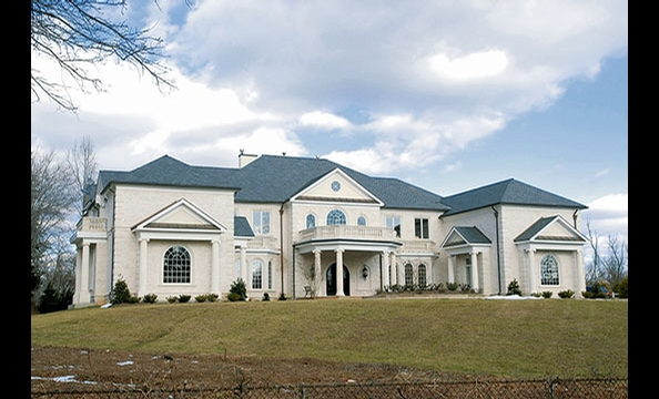 After pleading guilty in a mortgage scam, Bollywood producer Vijay Taneja sold this Potomac mansion for $5 million at auction.