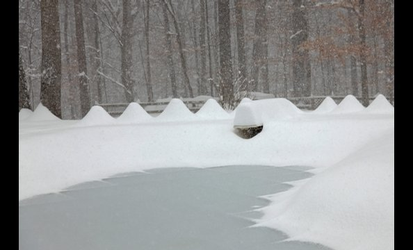 A snapshot from the blizzard in December. We think that's a diving board under that snow drift.