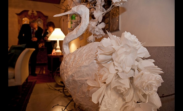 This paper-mâché creation keeps theme with a rose-covered tail.