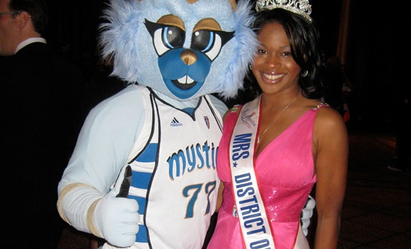 Mrs. District of Columbia Deanna McCray James enjoys the silent auction and cocktail hour at SneakerBall with Washington Mystics mascot, Lucky.