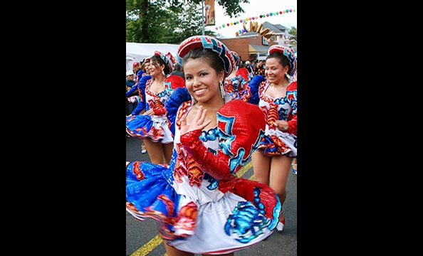 A young woman celebrates her heritage in Mt. Pleasant's Latino Festival.