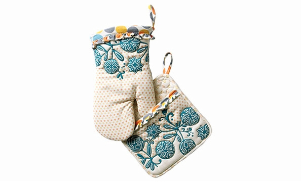 Anthropologie's kitchen accessories, like this pair of Dotty Match potholders, would make any cook happy. Anthropologie, $12.