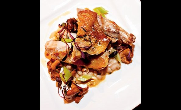 Pheasant breast is paired with a rustic, wintry stew of coco beans and chanterelle mushrooms at Eola in DC's Dupont Circle.