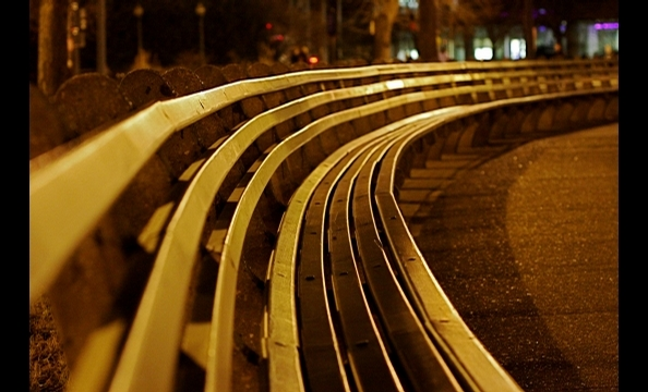 """The circular bench in Dupont Circle looks like electric stripes under the night lights,"" writes the photographer."