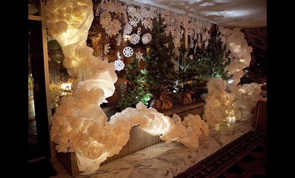 To honor COP15 and Denmark's remarkable commitment to eco-consciousness, the artists relied on materials they scavenged from recycling bins and studio shelves to create their ornamentation. This wintry scene was created from large-scale printing paper, co