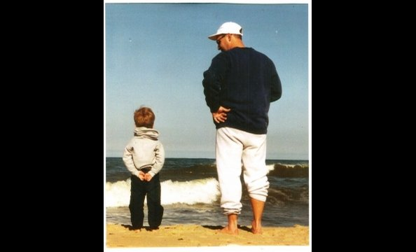 "Jenni Emory captured this moment between father and son during a vacation in Ocean City a few years ago. She writes, ""This photo always makes me smile when I look at it."""