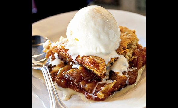 If there's a seasonal cobbler on the menu at Ray's the Steaks at East River, don't miss it.