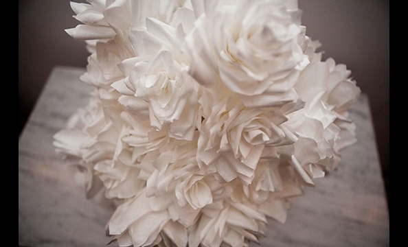 Giannasio created realistic looking flowers by curling the edges of her coffee filter petals with a toothpick.  Talk about labor intensive!