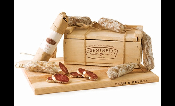 Artisan salami, flavored with truffles, Barolo wine, and juniper berries, packaged in a rustic wooden box. Creminelli Salami Trio gift box, $75.