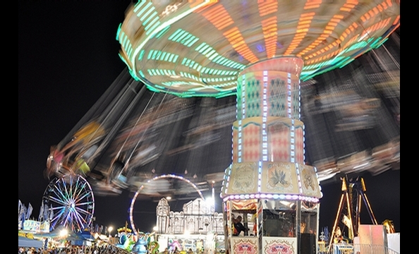 In a city focused on forging ahead, civil engineer Paul Koptya took a more circuitous approach to August's transportation-themed photo contest.  His electric photo of the swing ride at this summer's Montgomery County Fair—shot with long exposure on a Niko