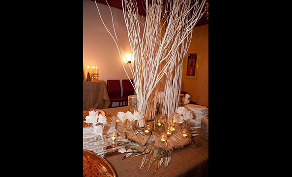 Chef Trina Hahnemann surrounded these winter tree branches with a menu of baked cod, pig jaw and onion jam, apple compote, and  kransekage—a traditional Danish marzipan ring cake— at the viewing party.