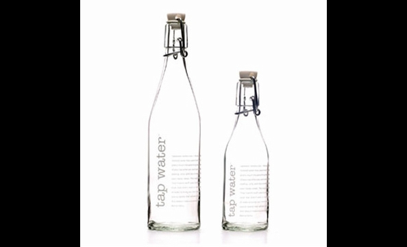 "She's consistently insisting she's just ""whipped things together,"" but we all know she loves to play hostess.  For your umpteenth Thanksgiving at her place, these cheeky water pitchers will help her stick to her story.  Reform School refillable tap water"