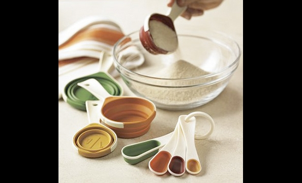 These rubber utensils are easy to clean and read, can be quickly stored together, and even come in Thanksgiving colors.  Fall collapsible measuring cups and spoons, $19.95.