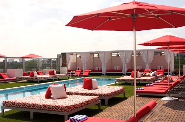 There are plenty of cabanas, chairs, and beds to lounge on around the pool.