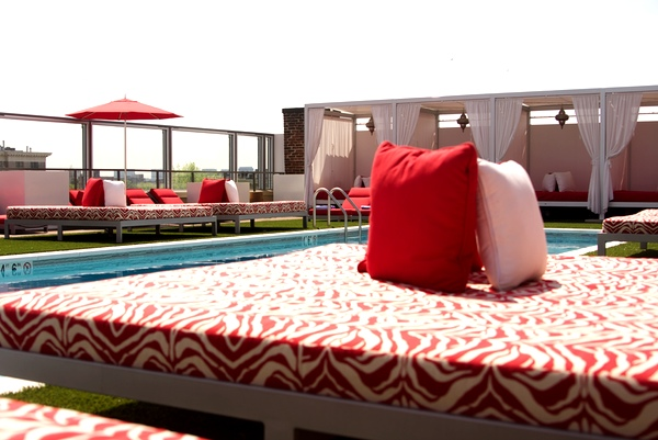 Hop from the pool to these large lounge beds to dry off.