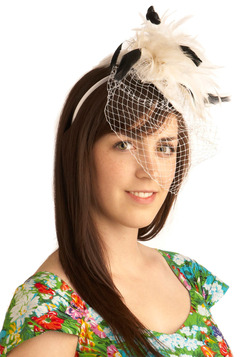 For another fascinator option, try this feathered headpiece.