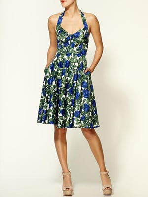 A halter top, knee-length skirt, and fun floral print make this dress too sweet to pass up.