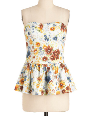 Pop a fitted blazer or cardigan over this floral strapless top, which is versatile enough to wear to work or on a date.