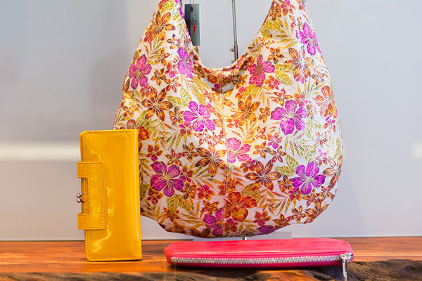 Clockwise from left: Nancy lemon patent leather wallet ($108), Gabor slouchy floral hobo bag ($298), and Millie fuchsia clutch, $98.