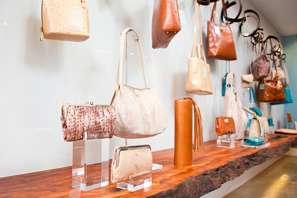 Neutral styles sit atop a live-edge bark shelf.