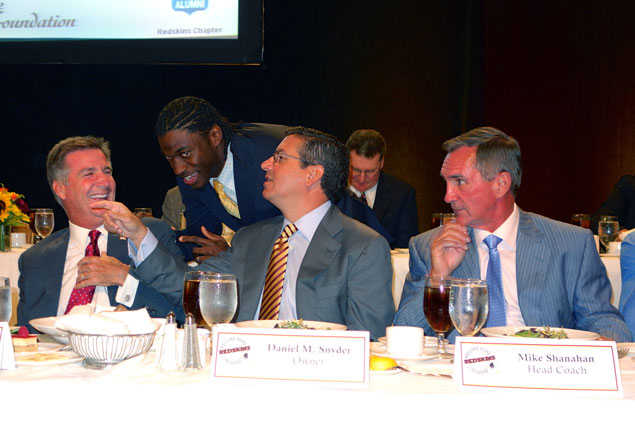 Caption This Photo: What Did Dan Snyder Say to Robert Griffin III?