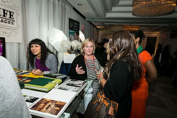 Jennifer Dominick Of Love Life Images Talks To Guests At Her Booth In The Ceremony Room Photograph By Michael Bennett Kress Photography