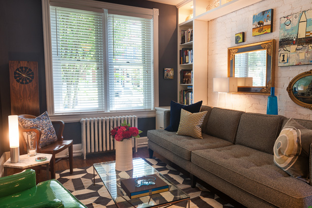 A Sofa From Room U0026 Board Backs Up To Exposed Brick And Custom Shelving In  The Living Room. The Cocktail Table Is Vintageu2014a Reclaimed Outdoor Table  Base With ...