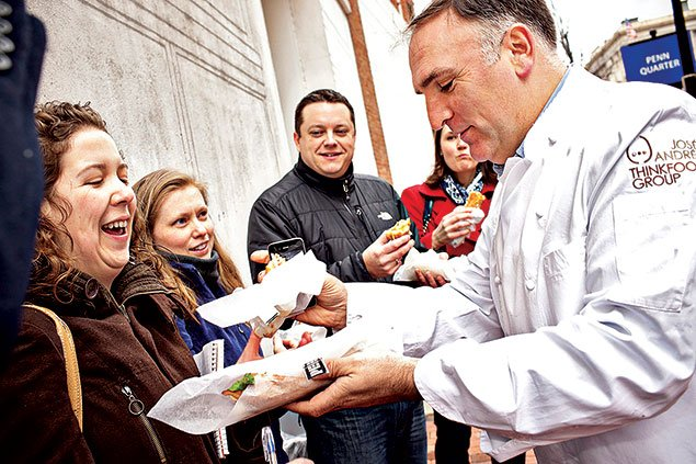 Chef José Andrés handing out sandwiches from his Pepe food truck. Photograph by Scott Suchman.