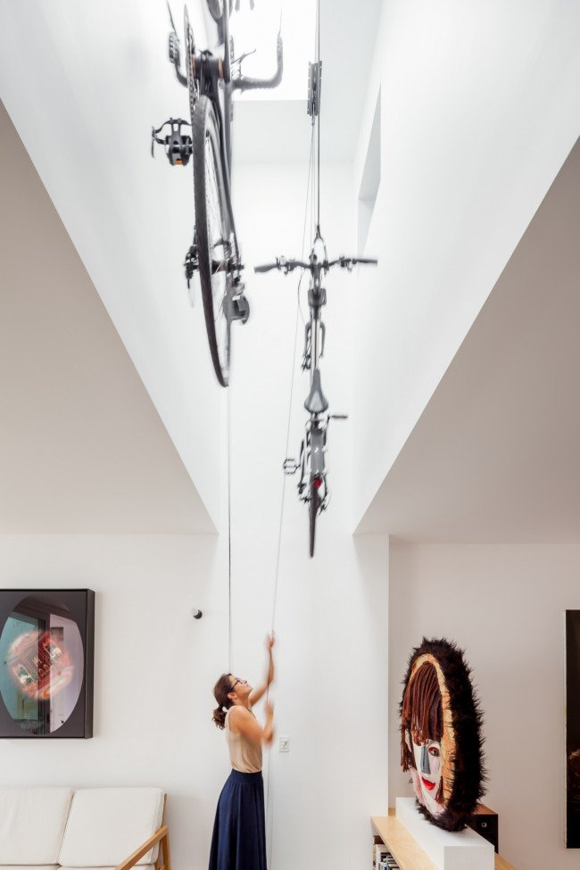 This family's bikes are rigged from the ceiling. Designed by Tribe Studio Architects. Photo via Jelanie Shop.