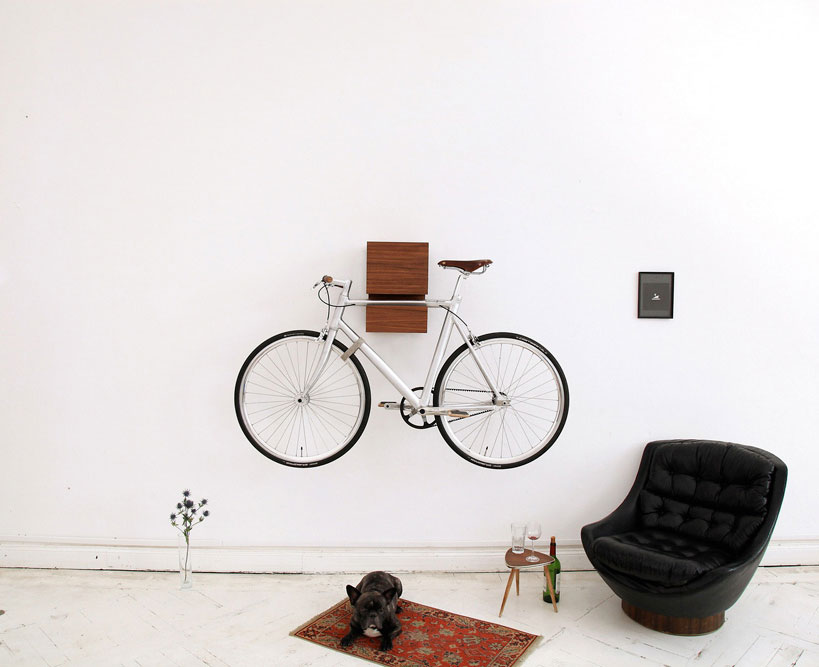 A bike hangs on a sculptural wooden wall shelf designed by Berlin brand Mikili. Photo via Artnau.