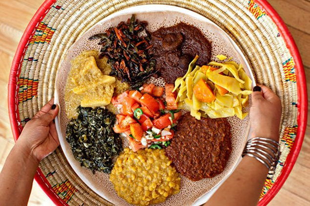 DC Staycation: Try the delicious <em>wats </em>and <em>injera</em> at Ethiopic. Photograph by Scott Suchman.