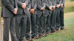 The Groomsmen Shoe Game is on POINT in This Coral and Gold Morais Vineyard Wedding