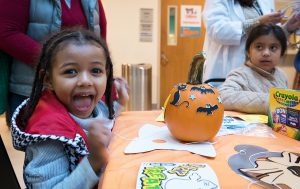 Photos: Kids at the Children's National Medical Center Celebrate Halloween With Pumpkin Crafts and Mini Parades
