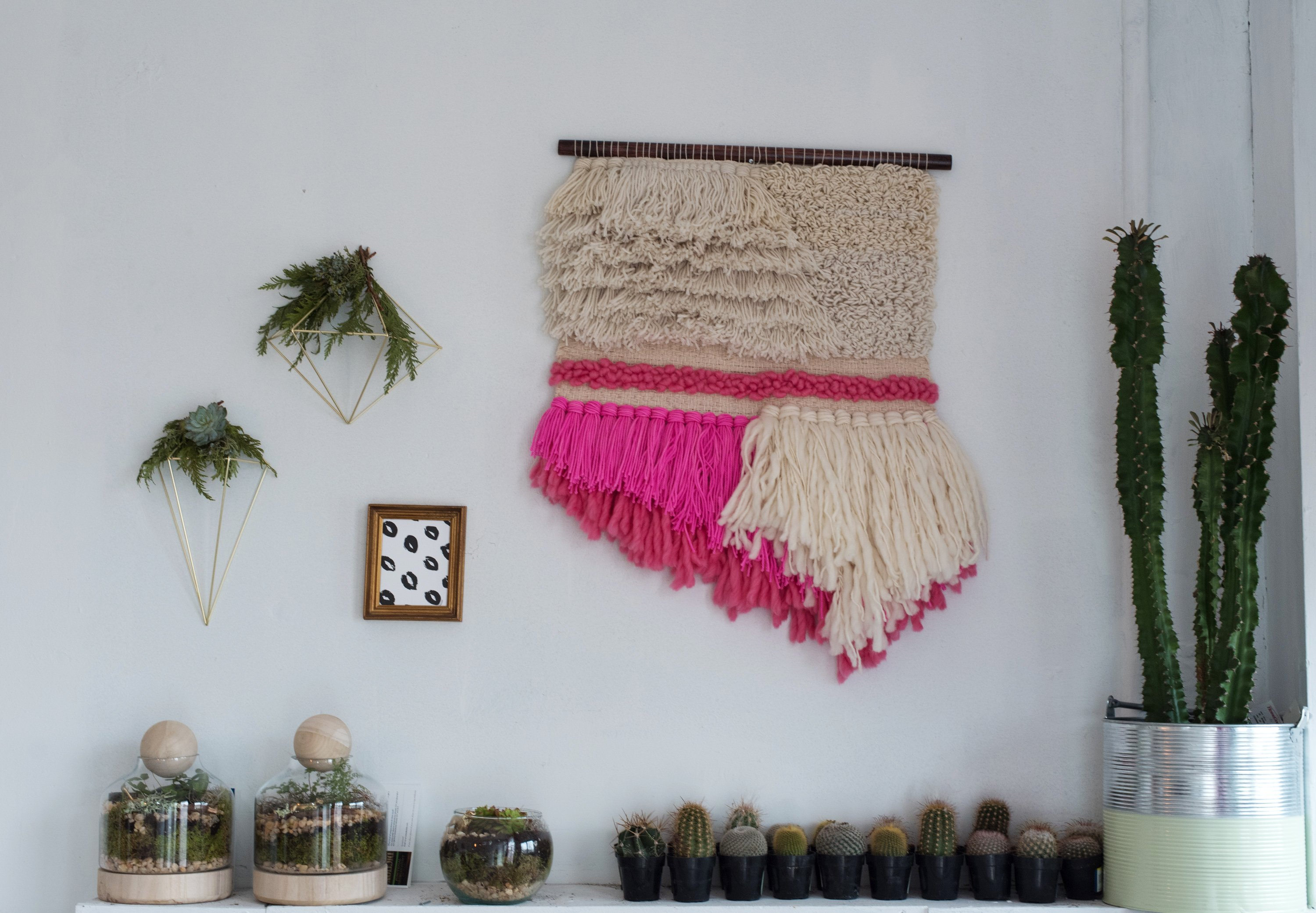 A Linny wall hanging adds a bolt of color above Simmons' cactus collection.