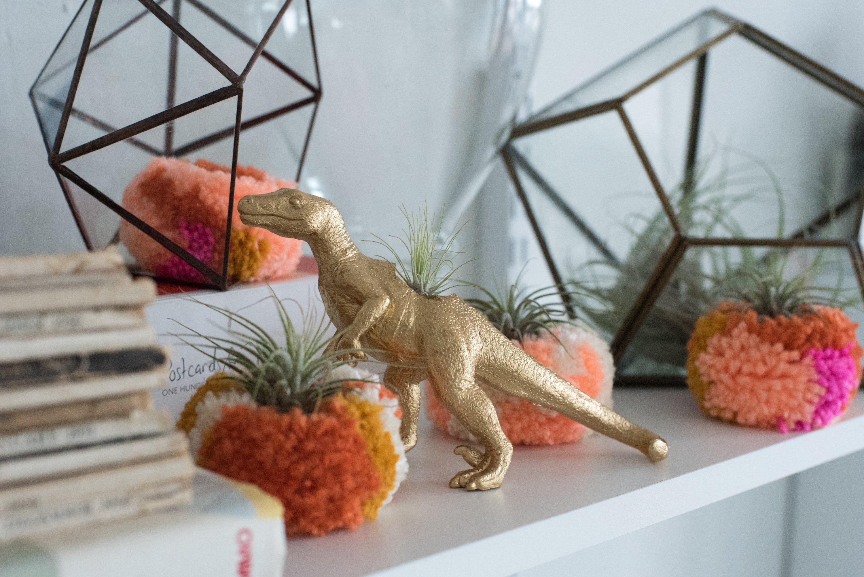 Spray-painted dinosaurs roam the studio.
