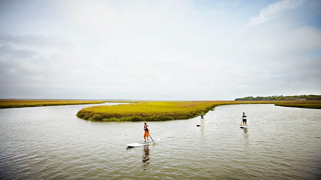 Go paddle boarding at Omni Amelia Island Plantation. Photograph courtesy of Omni Amelia Island Plantation Resort.