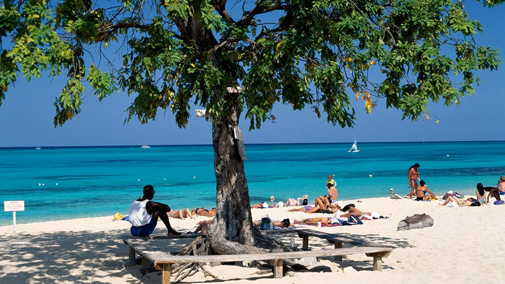 The beach in Montego Bay. Photograph by JTB Media Creation/Alamy.