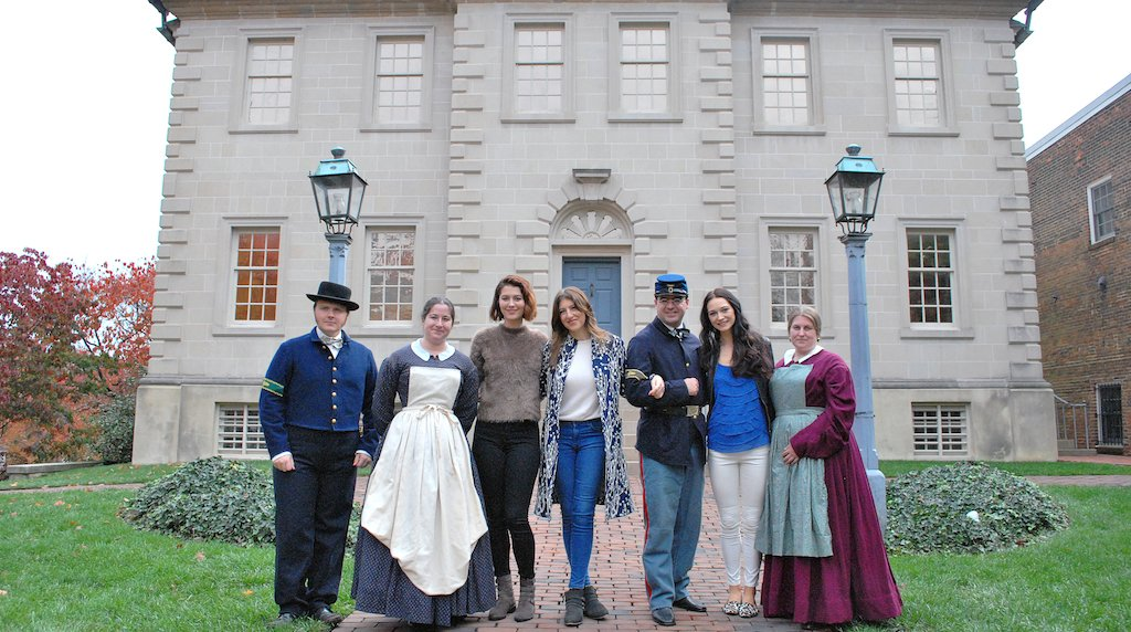 The cast of Mercy Street poses in front of Carlyle House. Photograph by M Enriquez for Visit Alexandria.